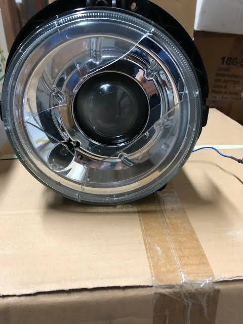FAIRLY USED  AMERICAN HEADLAMP