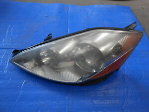 AUTHENTIC AMERICAN USED HEADLIGHT