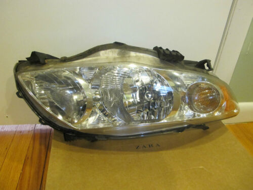 FAIRLY USED COROLLA 2010 HEADLIGHT SET