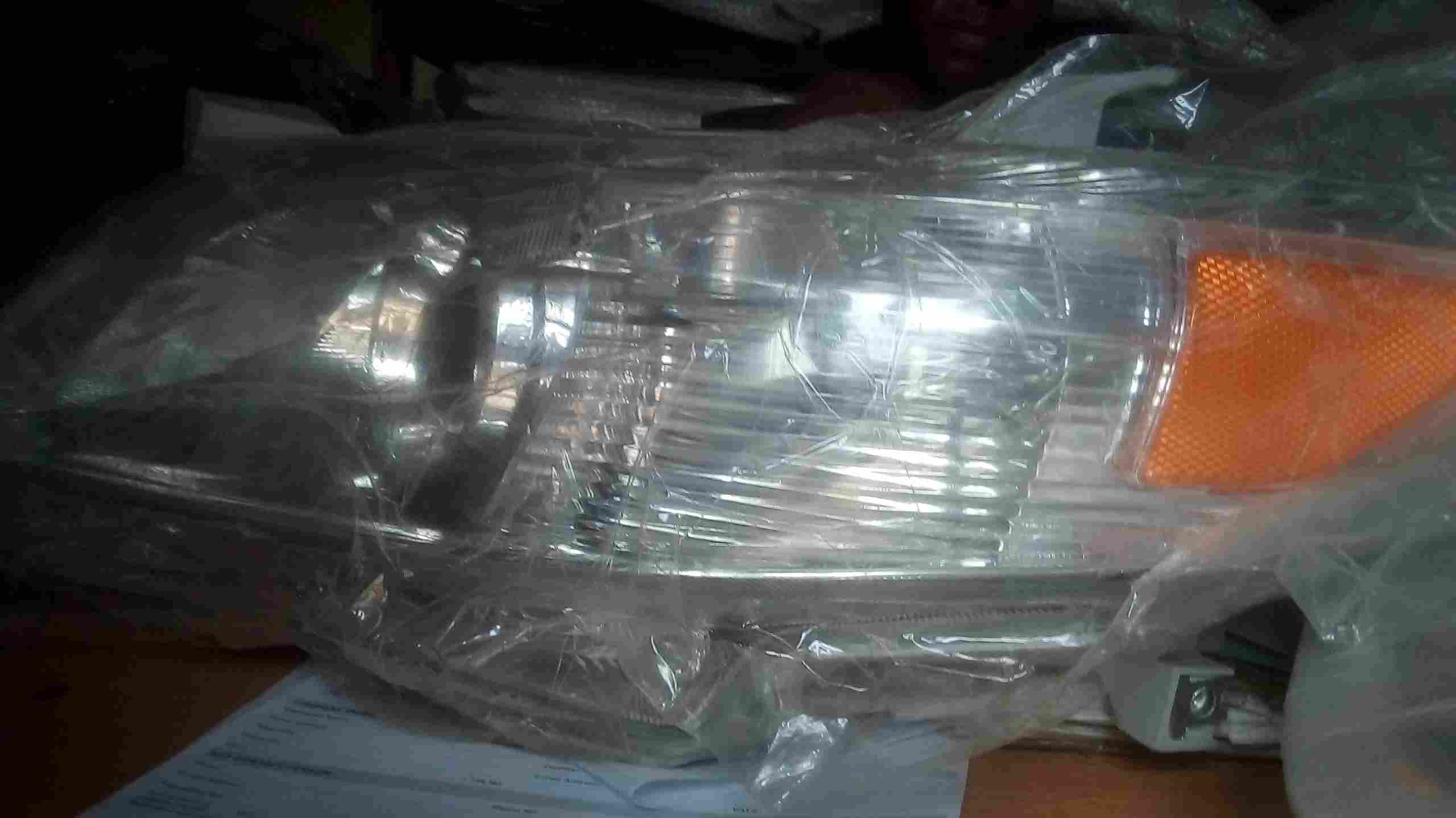 NEW GENUINE HIGHLANDER HEADLIGHT SET