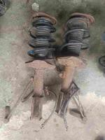 AMERICAN USED FRONT SHOCK ABSORBER WITH HUB