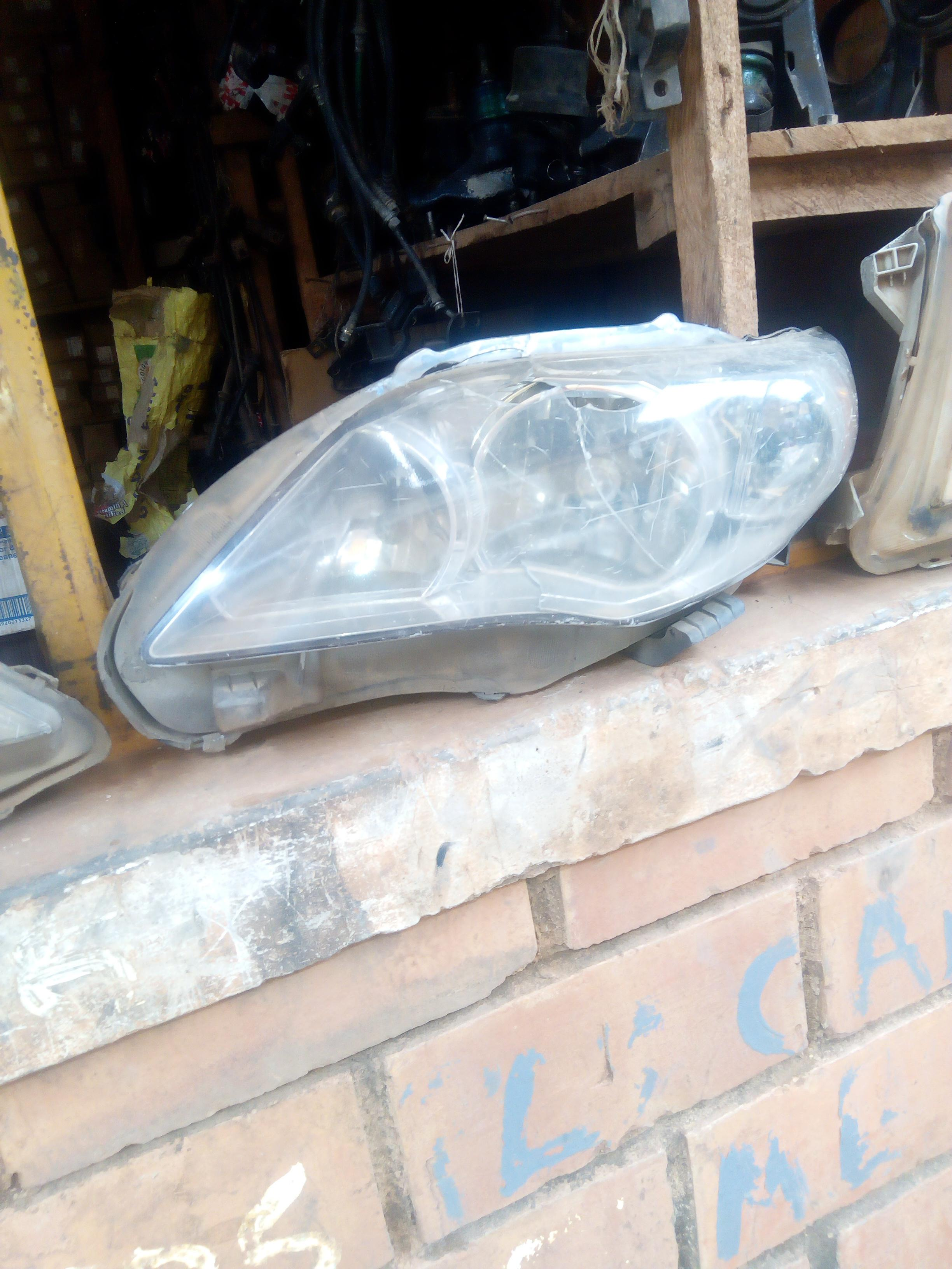 FAIRLY USED HEADLIGHT